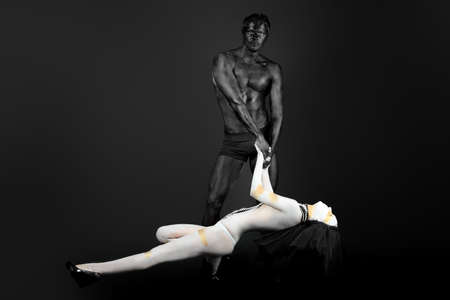 passionate couple: Passionate couple with bodies painted in white and black colors. Body painting project.  Stock Photo
