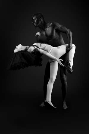 Passionate couple with bodies painted in white and black colors. Body painting project. Stock Photo - 7907255