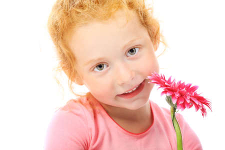 Portrait of a cute red-haired girl. Isolated over white background. photo