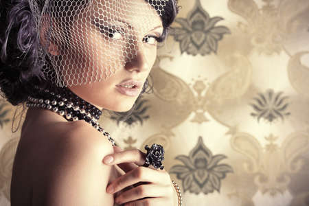 bead: Beautiful fashionable woman over vintage background.