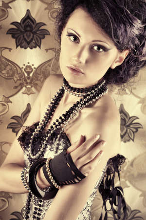 Beautiful fashionable woman over vintage background. Stock Photo - 7907321