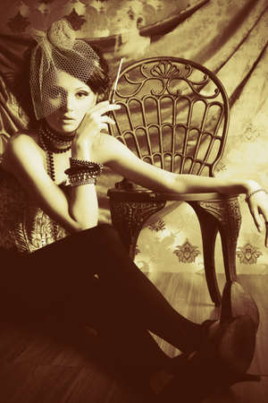 Beautiful fashionable woman over vintage background. Stock Photo - 7907316