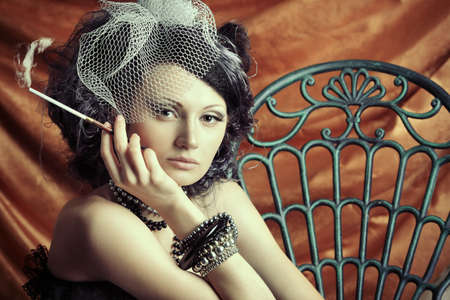 Portrait of a fashionable lady over vintage background. photo