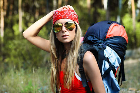 Young woman tourist making her journey. photo