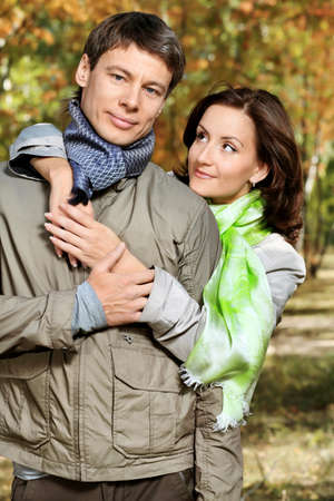 Happy married couple at the autumn park. Stock Photo - 7992480