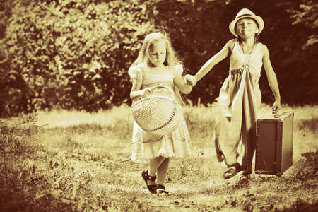 Two beautiful children walking together. Retro style. photo