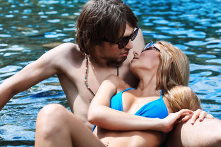 Happy young couple having a rest on a beach. photo