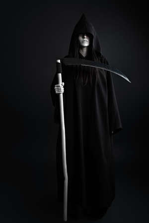 Woman death reaper over black background. Halloween. Stock Photo - 7992490