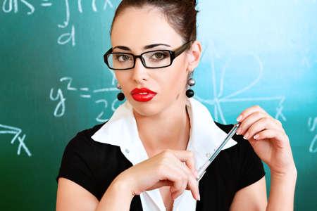 sexy teacher: Educational theme: portrait of a teacher giving a lecture.