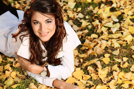 Young pretty woman at the autumn park Stock Photo - 7992543