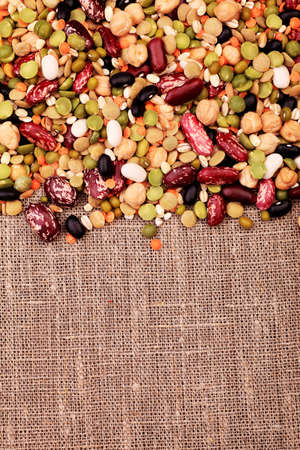 organic background: Food theme: kidney bean, lentil, peas and chick-pea background. Stock Photo