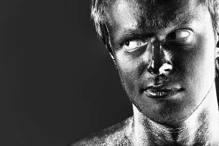 Portrait of expressive man painted with black color. Body painting project. Stock Photo - 8062518