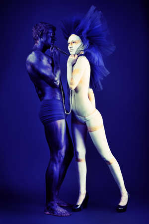 Passionate couple with bodies painted in white and black colors. Body painting project.  photo