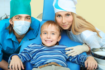 Shot of a little boy with dentists in a dental surgery. Healthcare, medicine. photo