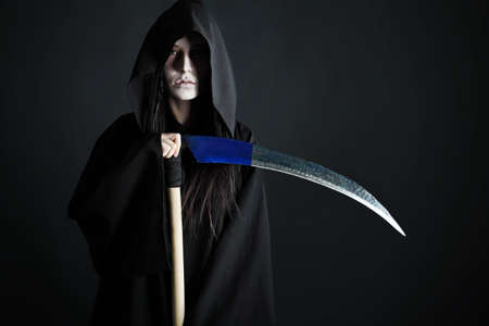 Woman death reaper over black background. Halloween. Stock Photo - 8088134