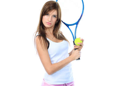 Portrait of a young girl with a tennis racket. Isolated over white background. Stock Photo - 8076998