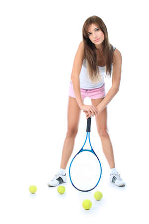 Portrait of a young girl with a tennis racket. Isolated over white background. Stock Photo - 8076995