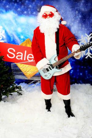 Christmas theme: Santa claus playing a guitar, snowy design. Stock Photo - 8109368