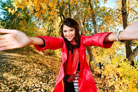 Young pretty woman at the autumn park. photo