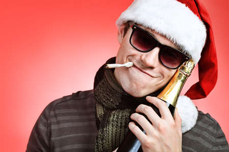 Portrait of a handsome young man in Santa Claus hat. Christmas. Stock Photo - 8160166