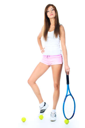 Portrait of a young girl with a tennis racket. Isolated over white background. photo