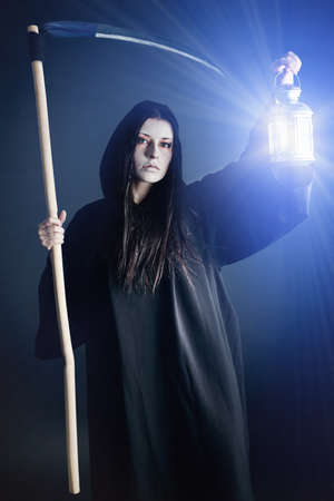 Woman death reaper over black background. Halloween. Stock Photo - 8160363