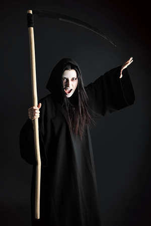 Woman death reaper over black background. Halloween. Stock Photo - 8160353