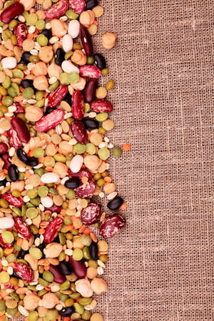 Food theme: kidney bean, lentil, peas and chick-pea background. photo