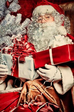 Christmas theme: Santa gifts, ina a interior. photo