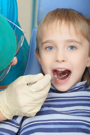 Shot of a little boy with a doctor in a dental surgery. Healthcare, medicine. photo