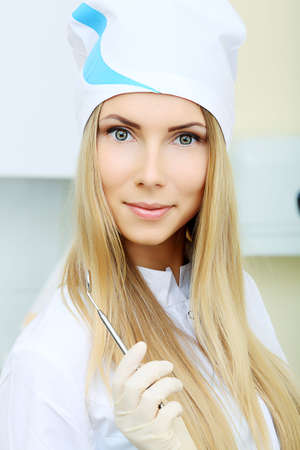 Shot of a woman dentist in a dental surgery. Healthcare, medicine. photo