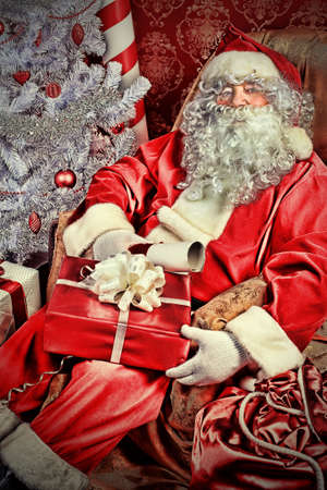 Christmas theme: Santa gifts, ina a interior. Stock Photo - 8217328