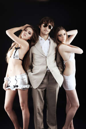 sexy lovers: Group of a stylish young people. Fashion, beauty, entertainment. Stock Photo