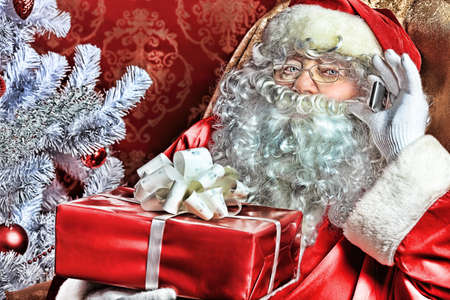 Christmas theme: Santa gifts, ina a interior. Stock Photo - 8217329