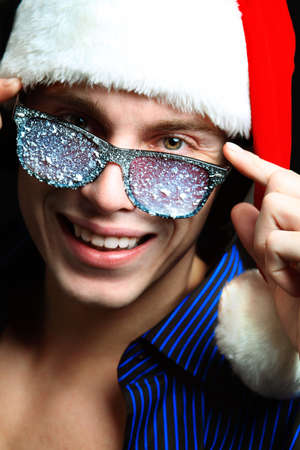 Portrait of a handsome young man in Santa Claus hat. Christmas. Stock Photo - 8217354