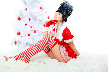 Beautiful young woman in Santa Claus clothes isolated over white background. Christmas. Stock Photo - 8217444