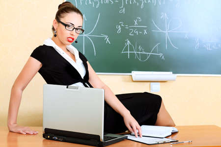 Educational theme: college teacher giving a lecture to students. Stock Photo - 8217426