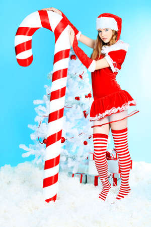 Beautiful young woman in Santa Claus clothes over Christmas background. Stock Photo - 8217457