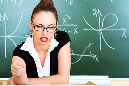 Educational theme: portrait of a strict teacher. photo