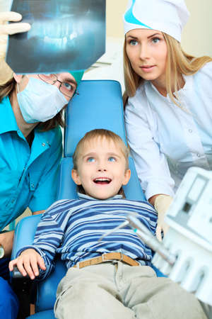 Shot of a little boy with dentists in a dental surgery. Healthcare, medicine. Stock Photo - 8303885