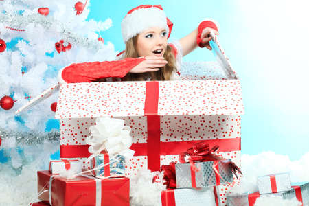 Beautiful young woman in Santa Claus clothes over Christmas background. Stock Photo - 8303818