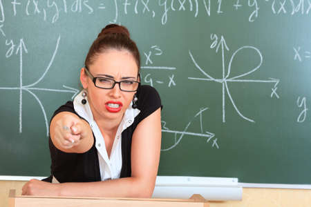 Educational theme: portrait of the angry teacher. photo