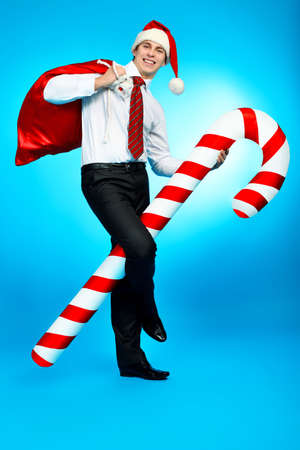 Portrait of a handsome business man in Santa Claus hat. Christmas. photo
