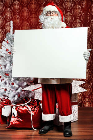 Portrait of Santa Claus holding white board. Christmas. Stock Photo - 8313878