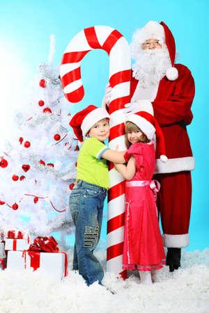 Christmas theme: Santa Claus and children having a fun.  photo