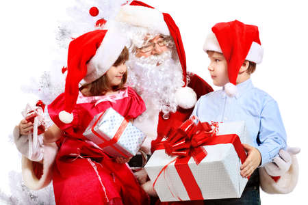claus: Christmas theme: Santa Claus and children having a fun. Isolated over white background.