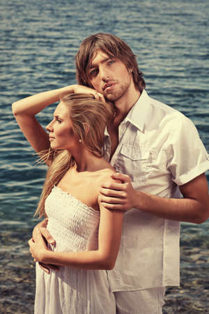 Beautiful young couple posing together over the sea. Stock Photo - 8318782