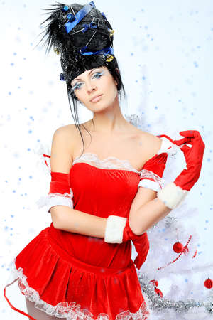 Beautiful young woman in Santa Claus clothes isolated over white background. Christmas. photo