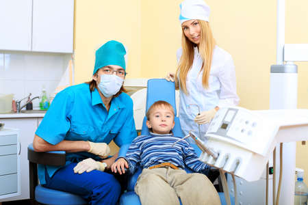 Shot of a little boy with dentists in a dental surgery. Healthcare, medicine. Stock Photo - 8318823