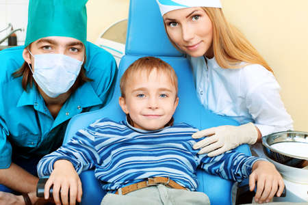 Shot of a little boy with dentists in a dental surgery. Healthcare, medicine. Stock Photo - 8318838